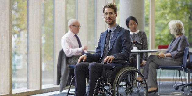 Businessman in wheelchair, meeting in