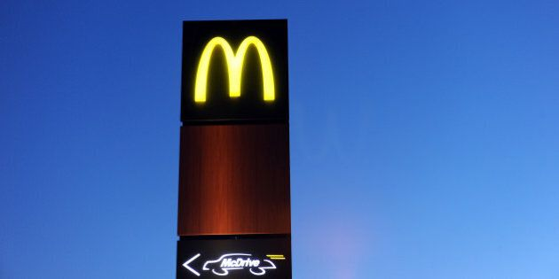 The neon sign of a Mac Donald's burger restaurant and a Mc Drive sign are pictured February 20, 2013...