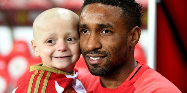 Bradley Lowrey (L) and Jermain Defoe of Sunderland (R) pre-match during the Premier League match between...