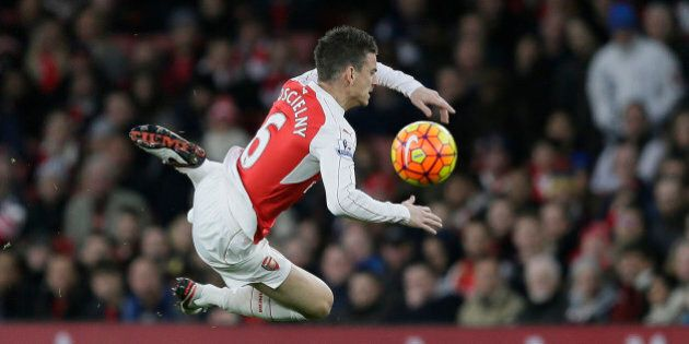 Arsenal's Laurent Koscielny goes down after a challenge from Sunderland's Ola Toivonen during the...