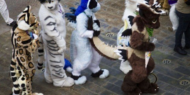 Delegates to the Eurofurence, 'Europe's biggest furry convention' dance at the conference hotel in Berlin on August 21, 2014. Fur friends attended the conference and the organisers describe themselves as 'a collection of artists, animators, writers, costumers, puppeteers, and just everyday fans who enjoy cartoon animals and their kind. Membership is open to any and all who like to imagine what it would be like if animals could walk and talk as we do' AFP PHOTO / ODD ANDERSEN        (Photo credit should read ODD ANDERSEN/AFP/Getty Images)