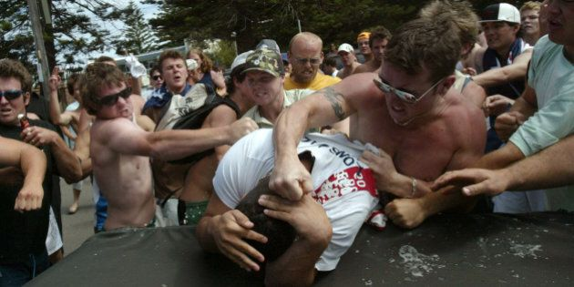 (AUSTRALIA & NEW ZEALAND OUT) Race riots. A mob beats and punches a man at North Cronulla. Hooligans...