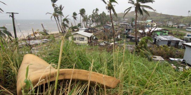 People inspect the damage at Namuimada village settlement on February 26, 2016, caused by Cyclone Winston...