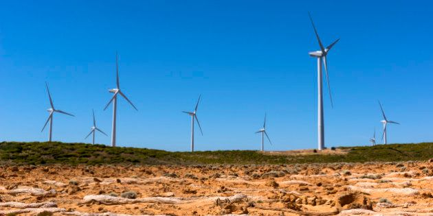 Portland Wind Farm wind turbines, Cape Bridgewater with Petrified Forest erosion in the foreground.