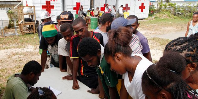People sign up for assistance at a Red Cross aid centre, days after Cyclone Pam in Port Vila, capital...