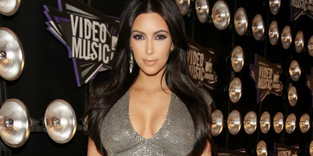LOS ANGELES, CA - AUGUST 28: TV Personality Kim Kardashian arrives at the 2011 MTV Video Music Awards...
