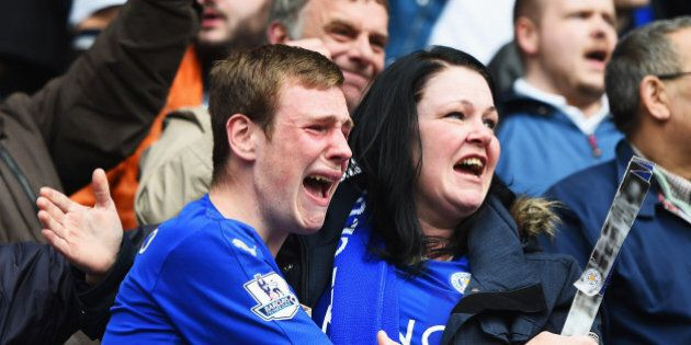 LEICESTER, ENGLAND - APRIL 03: Leicester City fans show their emotions as they celebrate victory after...