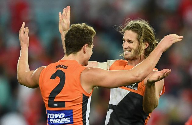 Giants co-captain Callan Ward (right) had plenty to smile about in his 150th
