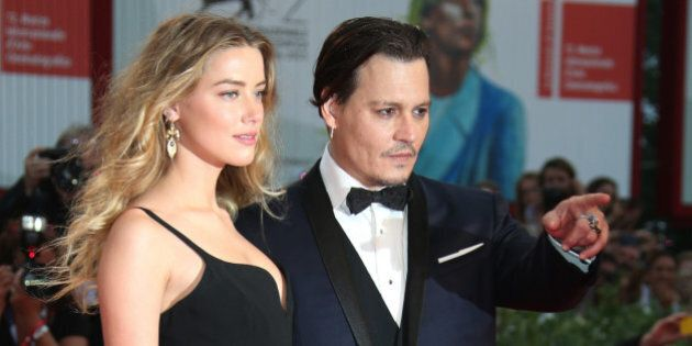 Amber Heard and Johnny Depp pose for photographers upon arrival at the premiere of the film Black Mass...