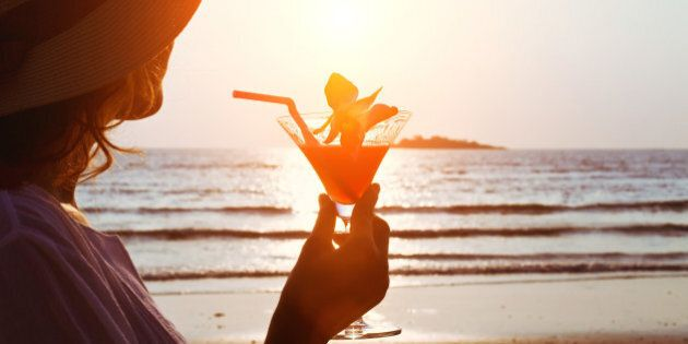 silhouette of woman with cocktail on the