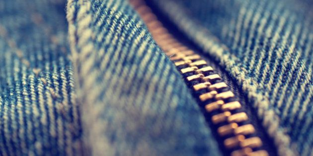 Macro of a zip on a pair of denim