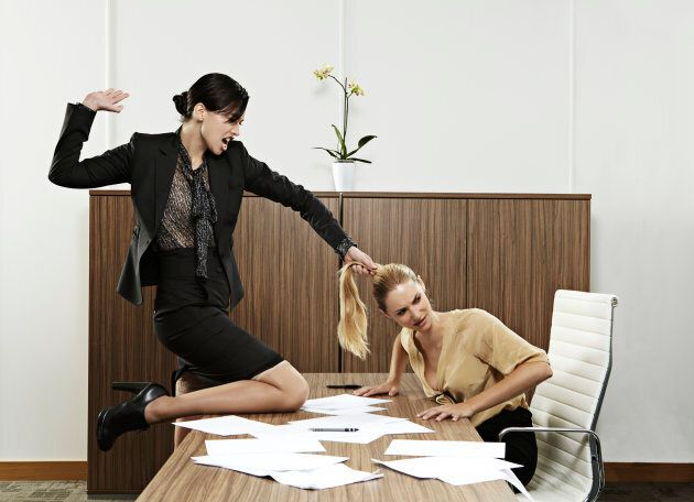 Unlike this stock photograph, workplace bullying may be subtle, but no less damaging over
