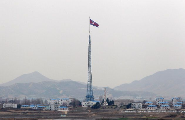 North Korea's 'Propaganda Village' lies under the shadow of the world's fourth tallest flagpole, carrying...
