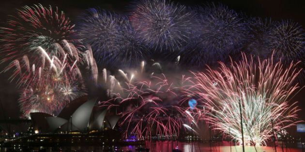 Fireworks explode over the Opera House and the Harbour Bridge during New Years Eve celebrations in Sydney,...