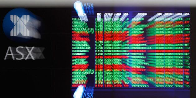 Stock information is displayed on an electronic board inside the Australian Securities Exchange, operated...