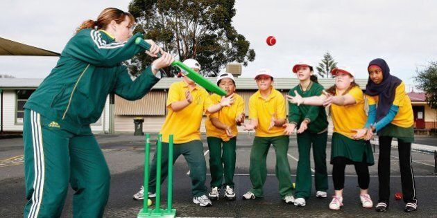 MELBOURNE, AUSTRALIA - AUGUST 01: Australian cricketer Karen Rolton plays cricket with students during...