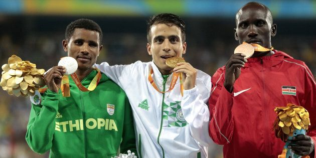 Abdellatif Baka of Algeria and Yeltsin Jacques of Brazil lead the pack in the men's 1500 meter T13 Final on Day 4 of the Rio 2016 Paralympic Games.
