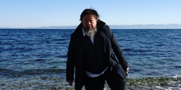 Chinese activist and artist Ai Weiwei walks on a beach near the town of Mytilene, on the Greek island...