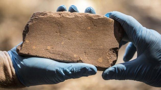 An axe-sharpening stone found inside the Kakadu National Park is one of a trove of artefacts proving...