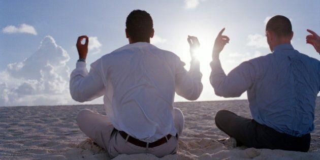 Bahamas, two businessmen meditating on beach, rear