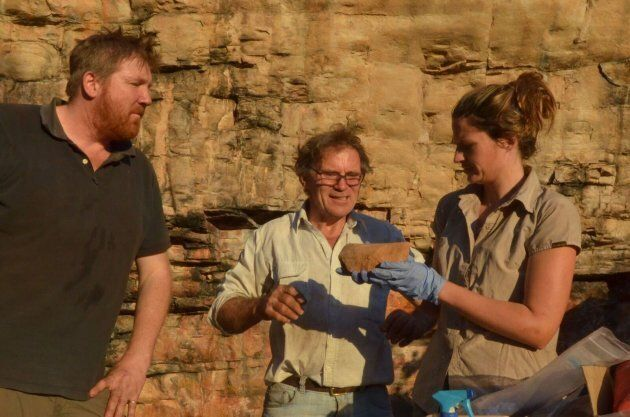 Lead archaeologist Chris Clarkson with Richard Fullagar and Elspeth Hayes examining a rare grindstone...