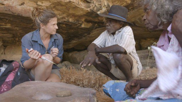 Elspeth Hayes examining some of the finds with Mark Djandjomerr and traditional owner May Nango at a...