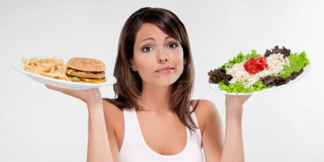 Woman choosing between a hamburger and