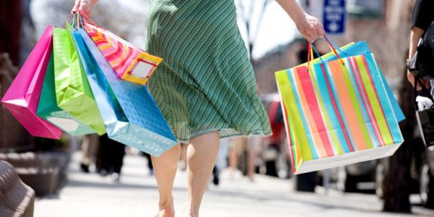 Cropped shot of woman with shopping