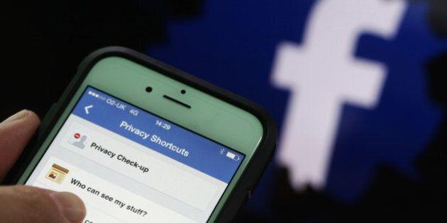 Privacy setting shortcuts are displayed on Apple Inc. iPhone 6 smartphone screen as a FaceBook Inc. logo...