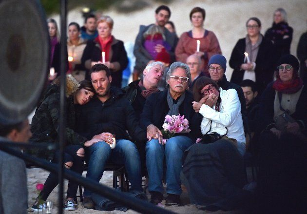 Justine Damond's family at a vigil held on Freshwater beach on Wednesday morning. Her brother Jason Ruszczyk...