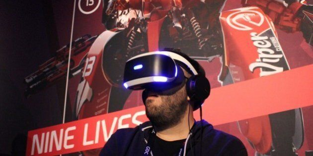 Nick Pino of TechRadar tries out a PlayStation VR video game at a Sony press event March 15, 2016 in...