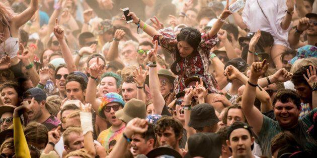 BYRON BAY, AUSTRALIA - DECEMBER 31: Festival goers enjoy the musical performances at Falls Festival on...