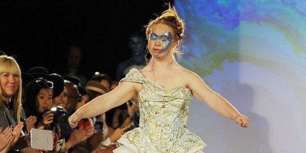 NEW YORK, NY - SEPTEMBER 13: Model Madeline Stuart walks the runway at Hendrik Vermeulen show during...