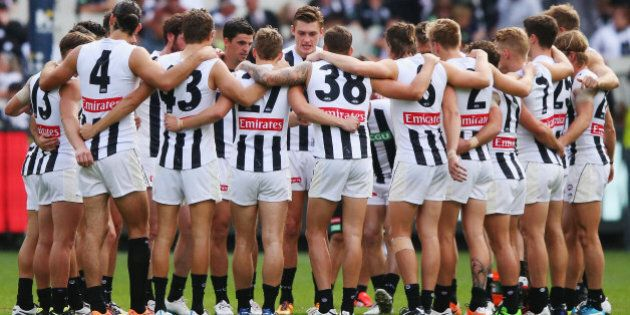 MELBOURNE, AUSTRALIA - APRIL 09: Magpies players huddle during the round three AFL match between the...