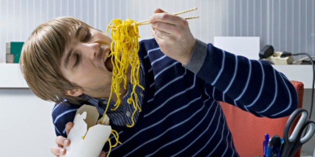 young office worker eating asian food