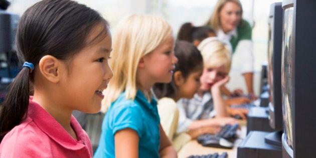 Kindergarten children learning how to use