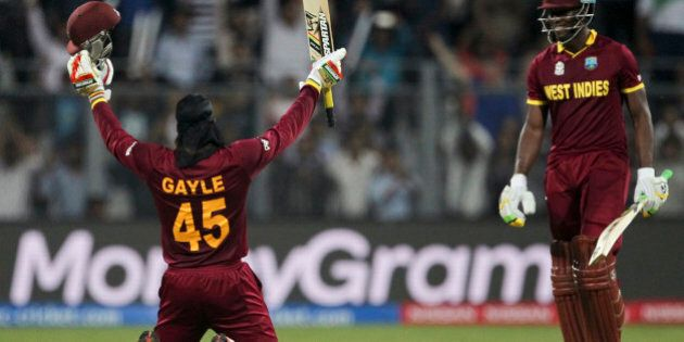 West Indies' Chris Gayle raises his bat after scoring hundred runs against England during their ICC...
