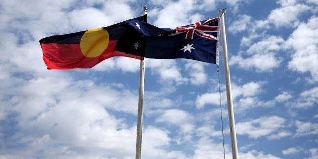 AVALON, AUSTRALIA - JANUARY 26:  The Australian and Aboriginal flags displayed on January 26, 2016 in Avalon, Australia.  Australia Day, formerly known as Foundation Day, is the official national day of Australia and is celebrated annually on January 26 to commemorate the arrival of the First Fleet to Sydney in 1788.  (Photo by Ashley Feder/Getty Images)