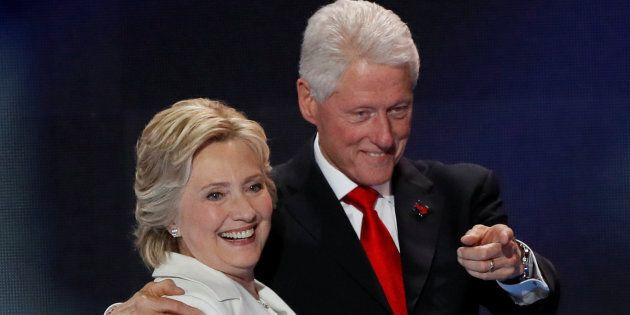 U.S. Democratic presidential nominee Hillary Clinton stands with her husband, former President Bill