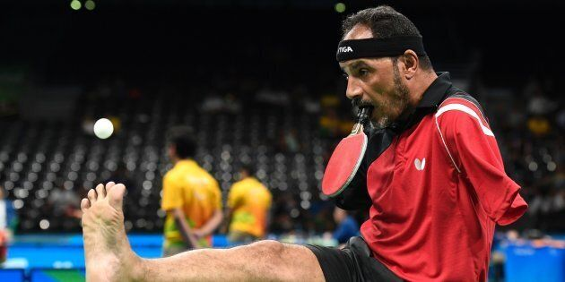 Egypt's Ibrahim Hamadtou serves with his foot at