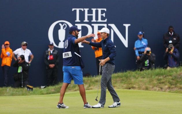 All good, bro. Player and caddie celebrate victory on the 18th with no offence taken.