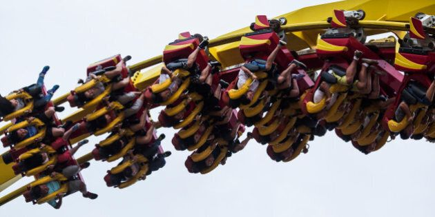 Visitors ride the Hair Raiser roller coaster at Ocean Park, operated by Ocean Park Corp., in Hong Kong,...