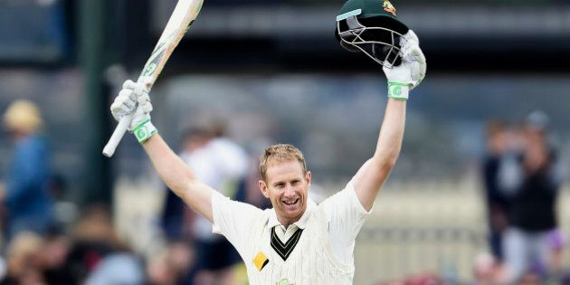 Australia's Adam Voges celebrates getting his double century against the West Indies during their cricket...