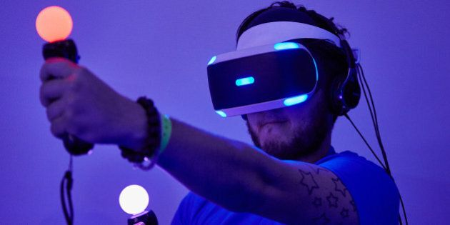 BIRMINGHAM, ENGLAND - SEPTEMBER 24: A gamer tests out Playstation VR (Virtual Reality) on the Sony PS4 on September 24, 2015 in Birmingham, England. The UK Gaming Industry contributed more than £1 billion to the UK's GDP in 2013 and estimates now put it's worth at  nearer £1.72 billion.  (Photo by M Bowles/Getty Images)