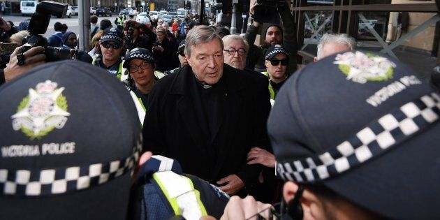 Cardinal George Pell arrives at Melbourne Magistrates Court on