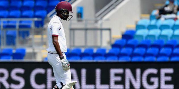 West Indies' Kraigg Brathwaite walks off the field being dismissed by Australia's Josh Hazlewood during...