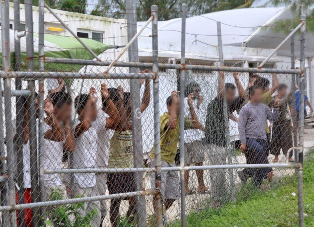 Asylum-seekers at the Manus Island detention centre in  2014