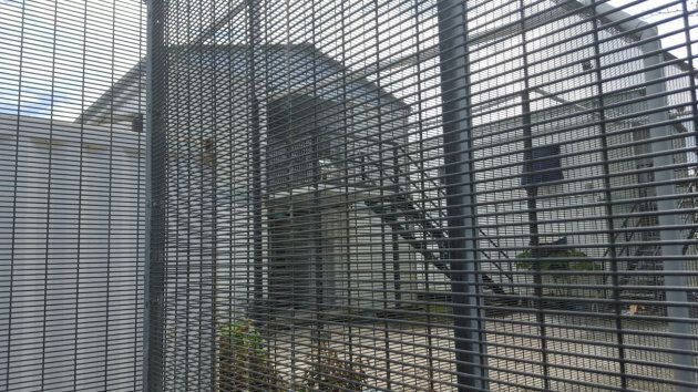 Security fences surround buildings inside the Manus Island detention