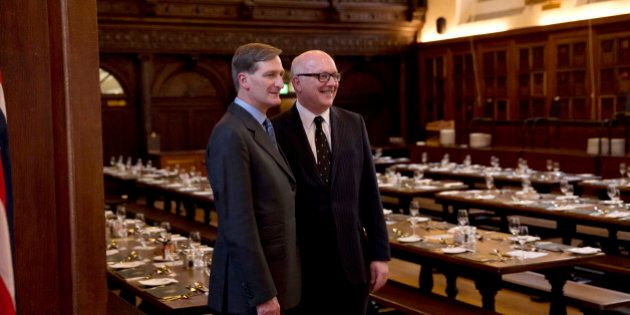 The Attorneys General Australia's George Brandis QC, right, and Britain's Dominic Grieve QC pose together for a photograph before an evening dinner in the Grand Hall of Gray's Inn in London, Wednesday, July 9, 2014.  The Attorneys General from Australia, Britain, Canada, New Zealand and the U.S. are meeting in London for a conference July 9 to 11 to discuss emerging issues and existing trends in fighting international cybercrime.  (AP Photo/Matt Dunham)