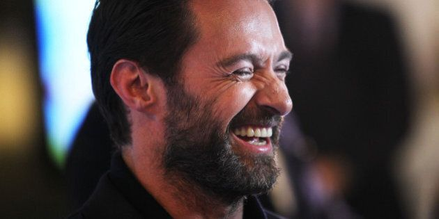 MELBOURNE, AUSTRALIA - MARCH 29: Hugh Jackman smiles he arrives on the red carpet ahead of the Eddie...